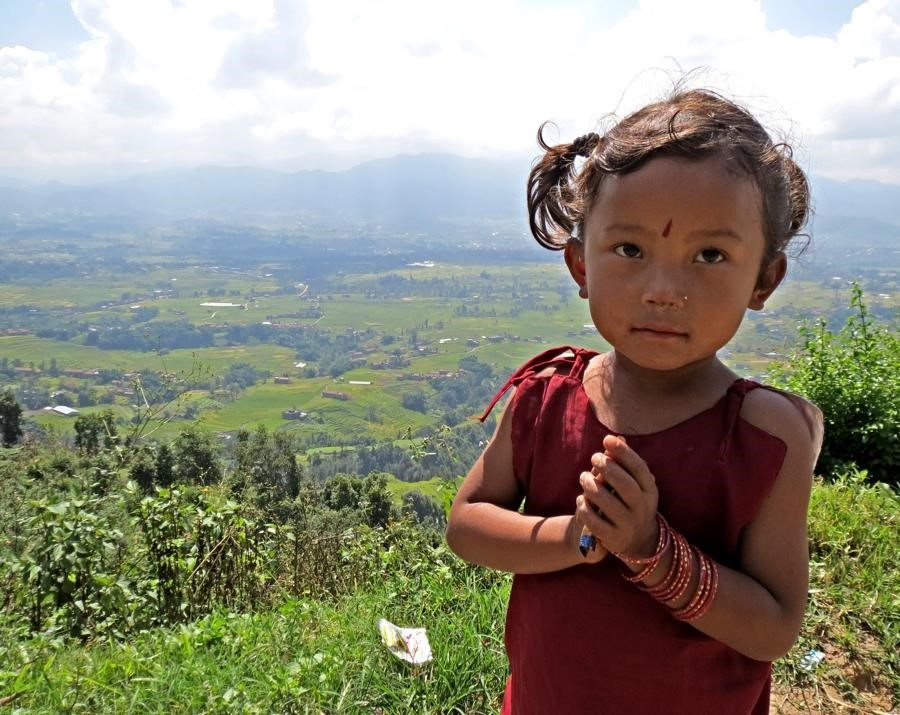 Child on hill in Nepal